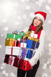Happy young woman holding many gift boxes Stock Photography