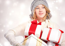 Happy young woman holding many gift boxes Royalty Free Stock Image