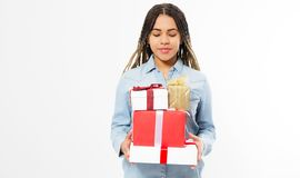 Happy young woman holding a many gift boxes - The concept of holidays and discounts in stores stock images