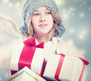 Happy young woman holding many gift boxes Royalty Free Stock Photos