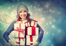 Happy young woman holding many present boxes Stock Image