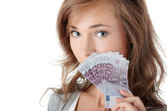 Happy young woman holding money Stock Images