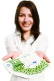 Happy young woman holding money stock photography