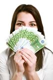 Happy young woman holding money Royalty Free Stock Image