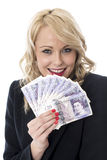 Happy Young Woman Holding Money Stock Photo
