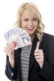 Happy Young Woman Holding Money with Thumbs Up Stock Photography