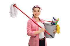 Happy young woman holding mop and bucket filled with cleaning pr Stock Photography
