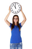 Happy young woman holding office clock Stock Photo