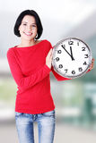 Happy young woman holding office clock Stock Photos