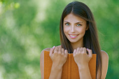 Happy young woman holding an orange Stock Images