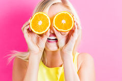 Happy Young Woman Holding Orange Halves Royalty Free Stock Photos