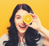 Happy young woman holding oranges Stock Photo