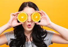 Happy young woman holding oranges Royalty Free Stock Photo
