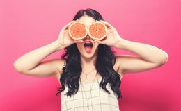 Happy young woman holding oranges Stock Images
