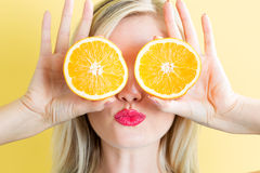 Happy young woman holding oranges Stock Image