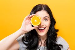 Happy young woman holding oranges Royalty Free Stock Images