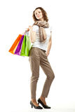 Happy young woman holding paper bags Stock Photo