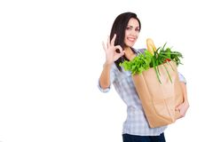Happy young woman holding paper shopping bag with Royalty Free Stock Images