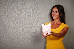 Happy young woman holding piggy bank Royalty Free Stock Images