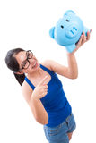 Happy young woman holding piggy bank Stock Image