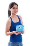 Happy young woman holding piggy bank Stock Photos