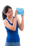 Happy young woman holding piggy bank Royalty Free Stock Photography