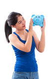 Happy young woman holding piggy bank Royalty Free Stock Photo
