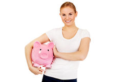Happy young woman holding piggybank Stock Photos