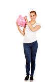 Happy young woman holding piggybank Royalty Free Stock Image
