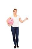 Happy young woman holding piggybank Stock Photos