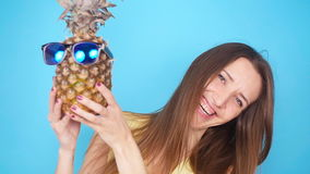 Happy young woman holding a pineapple stock video