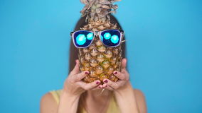 Happy young woman holding a pineapple stock video footage