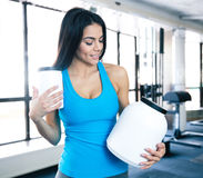 Happy young woman holding plastic container at gym Royalty Free Stock Photo