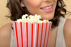 Happy Young Woman Holding Popcorn Royalty Free Stock Photography
