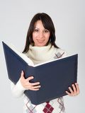Happy young woman holding an portfolio, isolated Royalty Free Stock Images