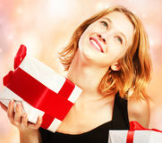 Happy young woman holding present boxes Stock Photos