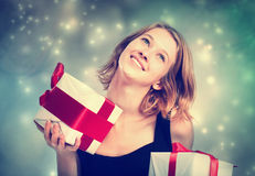 Happy young woman holding present boxes Stock Photo