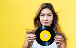 Happy young woman holding a record stock images