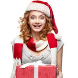 Happy young woman holding red gift Royalty Free Stock Photography