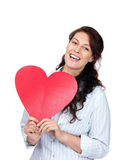 Happy young woman holding a red heart Royalty Free Stock Images