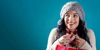 Happy young woman holding a shopping bag. On a solid background stock photography