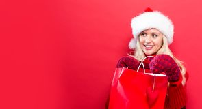 Happy young woman holding a shopping bag Stock Photo