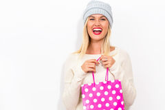 Happy young woman holding a shopping bag Royalty Free Stock Images