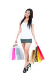 Happy Young Woman Holding Shopping Bags. Full-length portrait of a pretty young woman holding shopping bags over white background Royalty Free Stock Photo