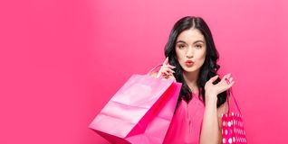 Happy young woman holding shopping bags stock image