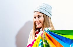 Happy young woman holding shopping bags Royalty Free Stock Images