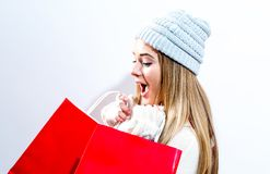 Happy young woman holding shopping bags. On a white background Stock Photo