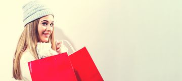 Happy young woman holding shopping bags. On a white background Stock Images