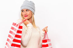 Happy young woman holding shopping bags. On a white background Royalty Free Stock Image