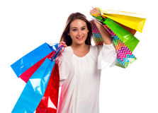 Happy young woman holding shopping bags Stock Photography
